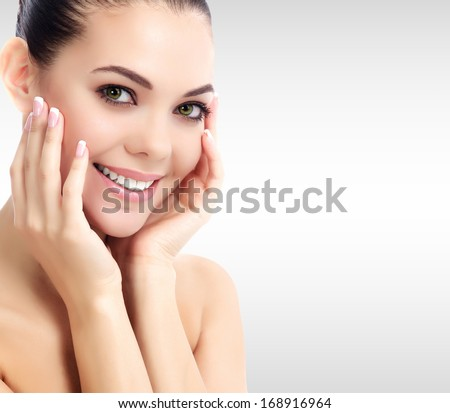 Pretty woman against a grey background with copyspace.  - stock photo