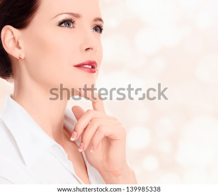 Pretty woman against abstract background with circles and copyspace - stock photo