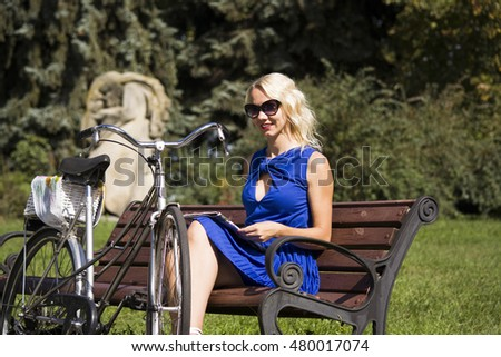 pretty woman and an old bicycle