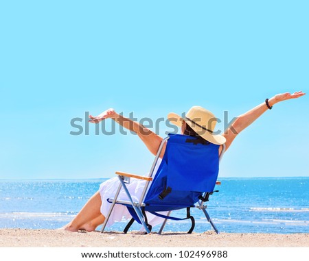 Pretty woman at the beach in summer portrait - stock photo