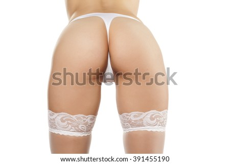 pretty woman buttocks in the white thong and stockings - stock photo