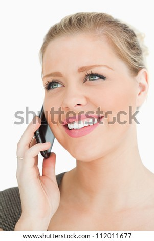 Pretty woman calling with her smartphone against a white background
