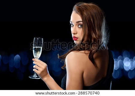 Pretty Woman celebrating with Champagne - stock photo