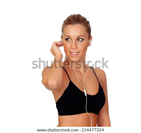 Pretty woman doing fitness listening music with headphones on white background isolated - stock photo