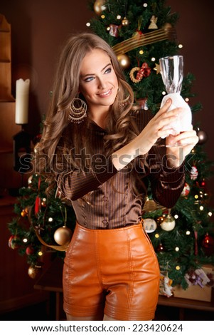 Pretty woman during Christmas preparation - stock photo