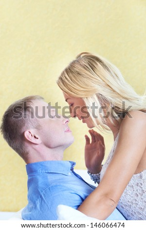 Pretty woman embracing her husband and looking at him - stock photo