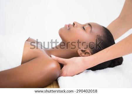 Pretty woman enjoying a shoulder massage at the health spa - stock photo