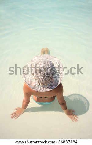 Pretty woman enjoying a swimming pool in Greece