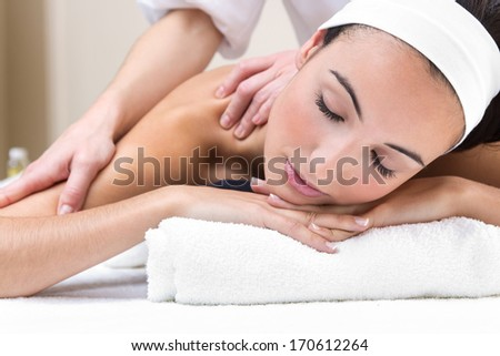 Pretty Woman enjoying shoulder massage at beauty spa