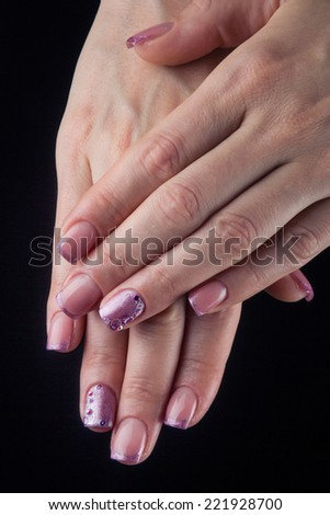 Pretty woman hand with perfect painted nails isolated on black background