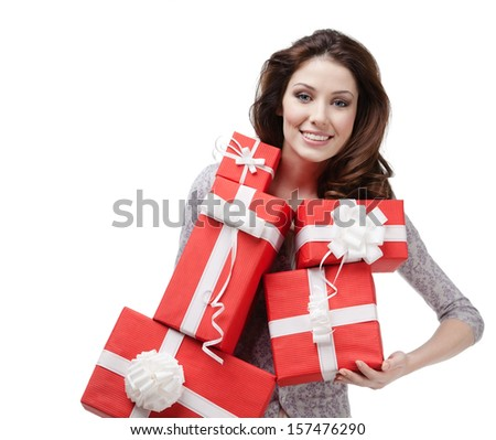 Pretty woman hands a great amount of red gift boxes, isolated on white - stock photo