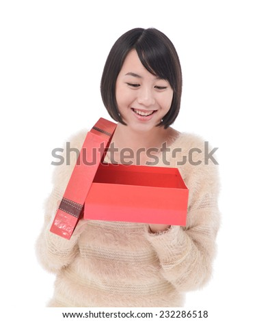 Pretty woman hands a red gift boxes - stock photo