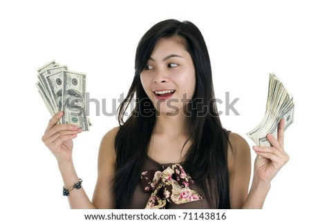 pretty woman happy with lots of money, isolated on white background