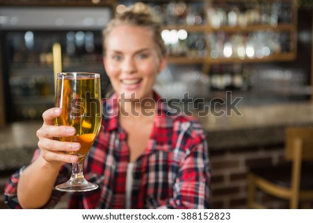 Pretty woman having a beer in a pub