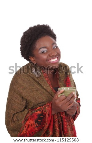 Pretty woman holding a cup of warm tea