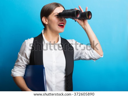 Pretty woman holding binoculars. Searching for new opportunities business concept - stock photo