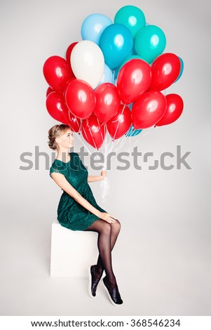 Pretty Woman Holding Colorful Balloons - stock photo
