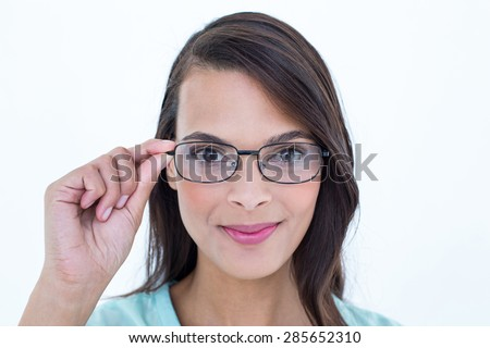 Pretty woman holding her eyeglasses in white background