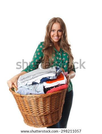 Pretty woman holding the collected dried clothes
