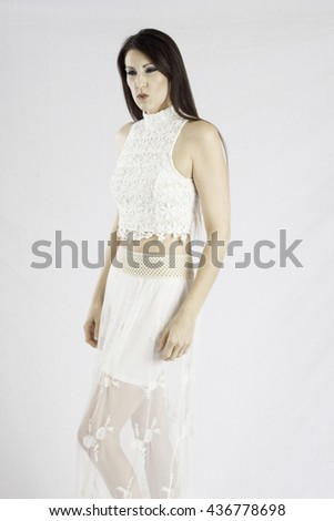Pretty woman in a white dress,  looking thoughtfully at the camera   - stock photo