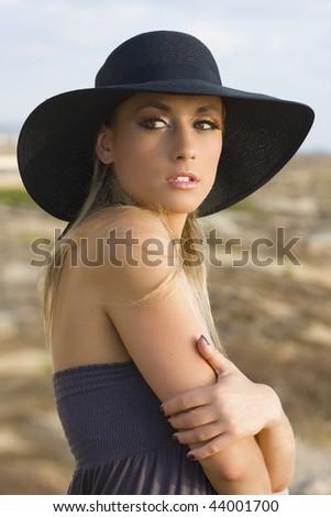 pretty woman in black hat - stock photo