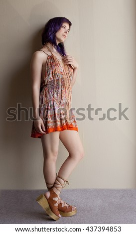 Pretty Woman in Colorful Dress and Cross Body Gold Chain Jewelry