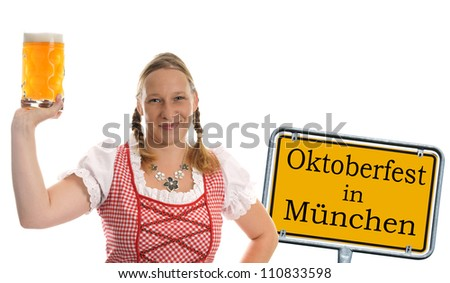 pretty woman in dirndl and Pint / munich beer festival - stock photo