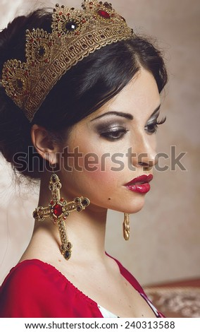 Pretty woman in golden crown  - stock photo