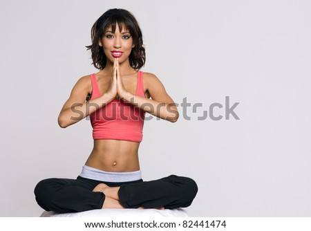 Pretty woman in lotus meditation - stock photo