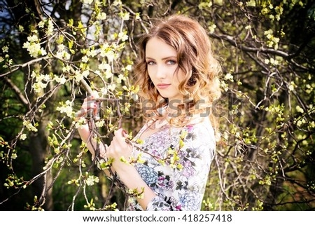 pretty woman in nature / Woman - stock photo