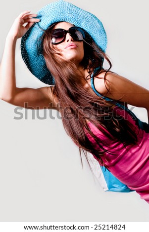 pretty woman in pink summer dress, hat and sunglasses