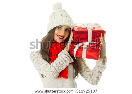 pretty woman in warm sweater and red scarf with red gift in hands isolated on white background