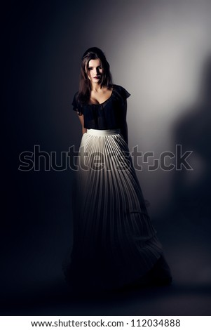 pretty woman in white skirt and black top - stock photo