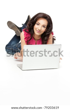 pretty woman laying down smiling with laptop