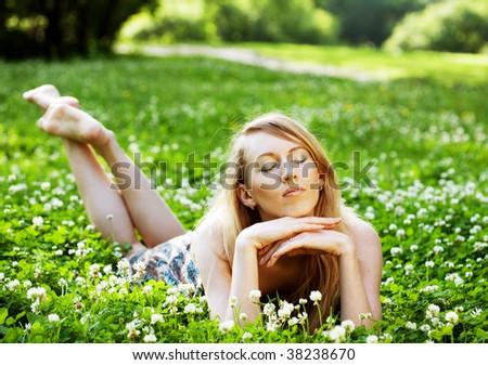 Pretty woman laying on  the grass - stock photo