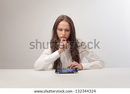 pretty woman looking tablet - stock photo