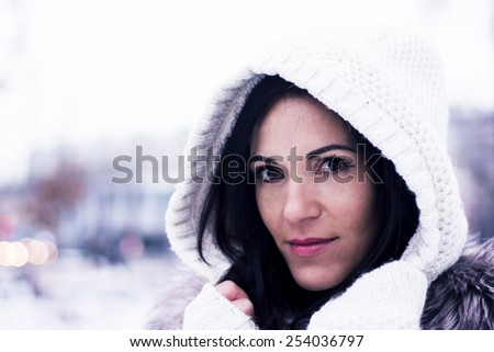 Pretty woman looking wearing the knitwear hood