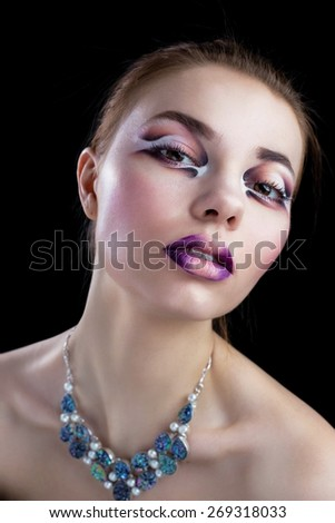 Pretty woman model face with artistic make up and necklace