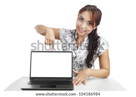 Pretty woman pointing on blank screen of ultrabook laptop computer