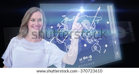 Pretty woman pointing with her finger against global business interface - stock photo