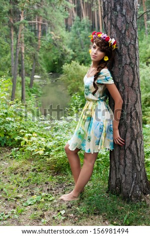 Pretty Woman Portrait with Wreath of Flowers. Natural Beauty