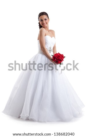 Pretty woman posing in wedding dress with bouquet - stock photo