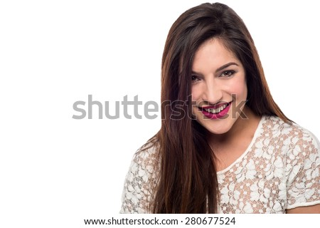 Pretty woman posing with delighted smile