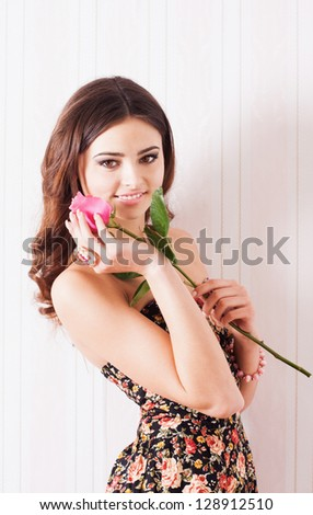 Pretty woman posing with rose - stock photo