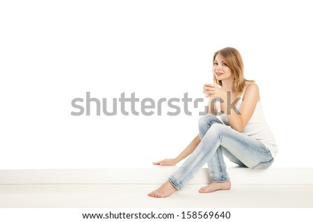 Pretty woman relaxing at home and drink a coffee over white