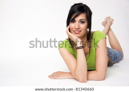 Pretty Woman Relaxing Casual Laying on White Floor Background - stock photo
