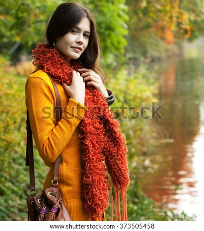 pretty woman relaxing in the autumn park - stock photo