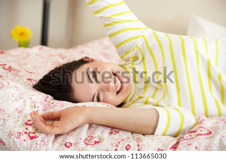 Pretty Woman Relaxing On Bed - stock photo