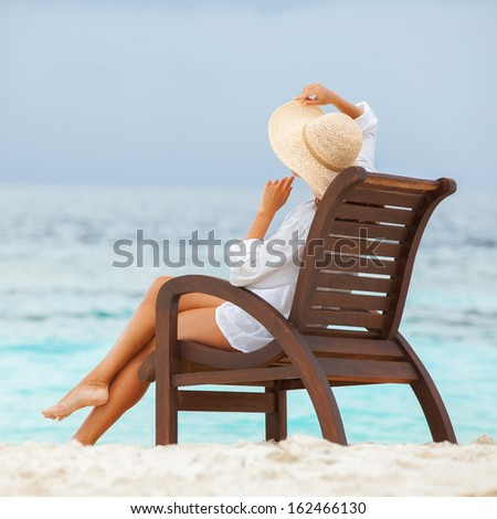 Pretty woman relaxing on the beach - stock photo