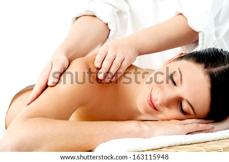 Pretty woman relaxing while getting body massage
